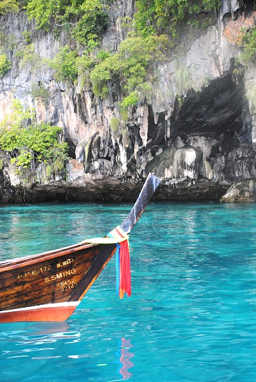 brown wooden boat on the ocean photo