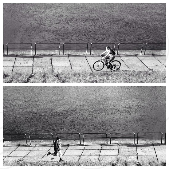 black and white man riding a bicycle photo photo