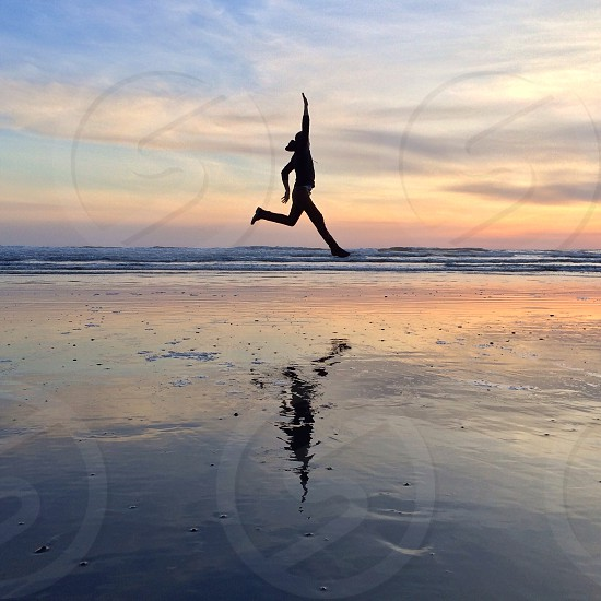 woman jumping in water like walking on the air photo