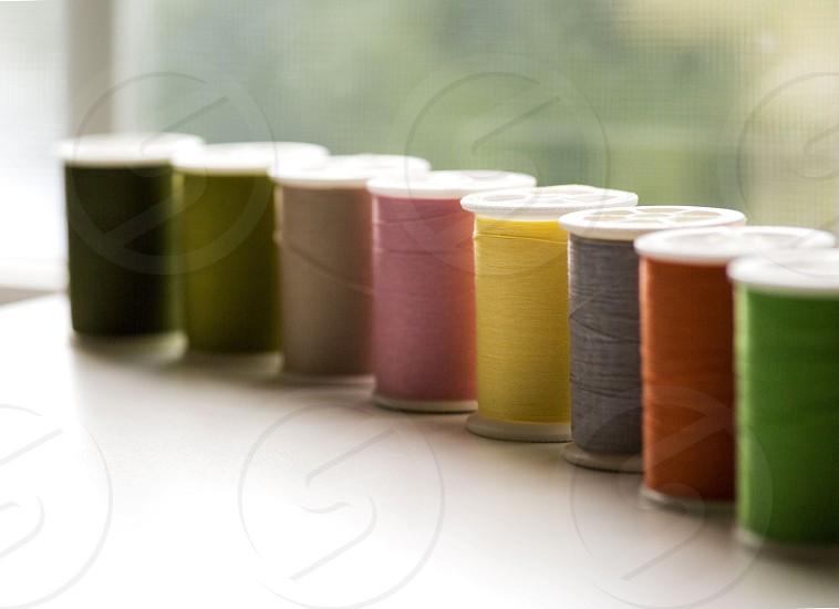 green brown pink yellow grey and orange threads photo