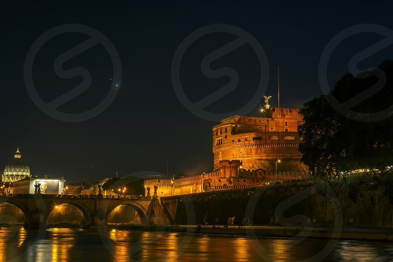 Night scene at the Mausoleum of Hadrian in Rome with river tiber photo