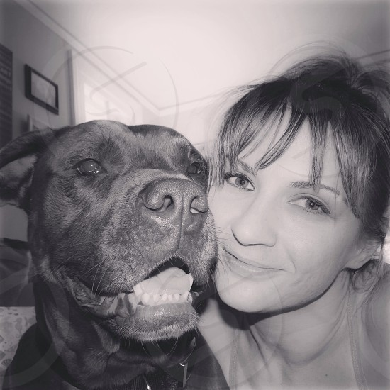 A girl and her dog dog canine female young woman black and white smiles hugs two 2 monochromatic monotone grayscale rescue shelter Remy remington faces love family adore adoration cute beautiful close up pitbull pit bull lover not a fighter sweet buddies friends man's best friend BFF  photo