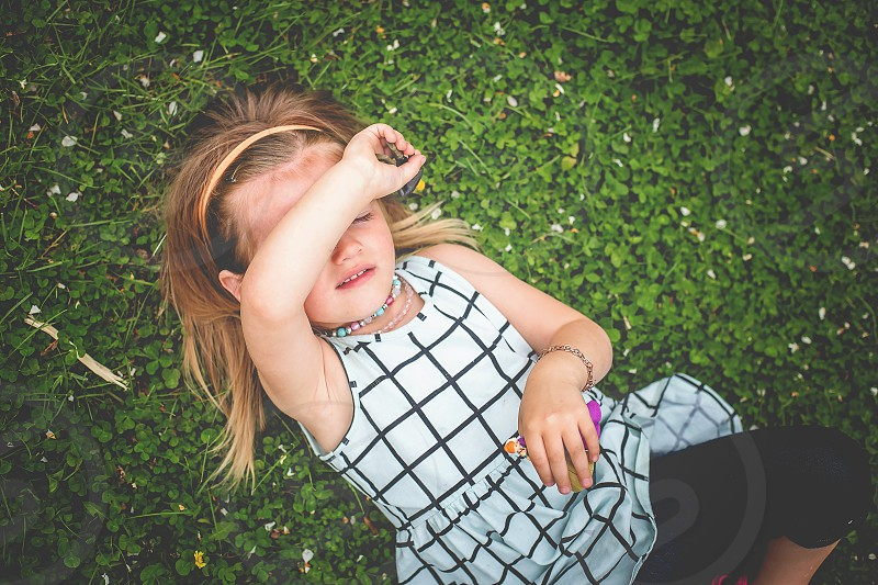 girl in clovers grass girl child photo