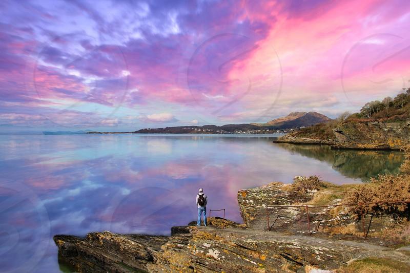 Sunsetskydramaticwaterrocks photo