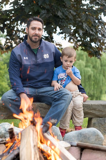 Father's Day   Keywords:  Father Son Dad Siblings Children Kids Family Bonfire Fire Summer Outdoors Nature. photo