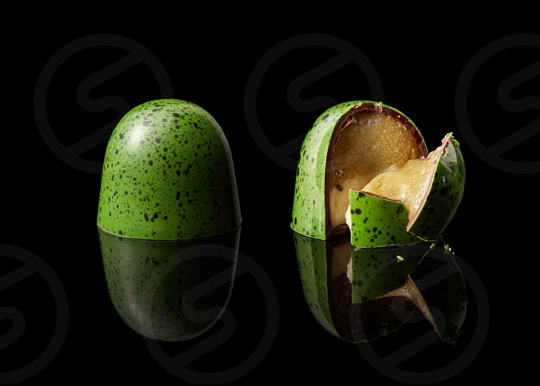 tasty yellow chocolate candy on a black background photo