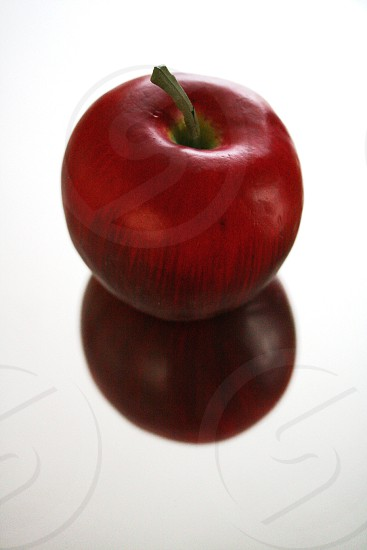Red apple reflection on mirror photo