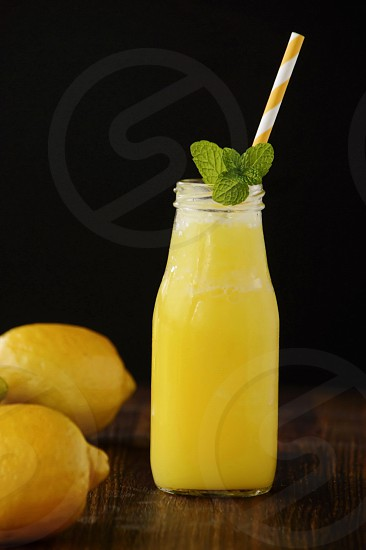 Lemon French Vanilla Smoothie with a sprig of mint photo