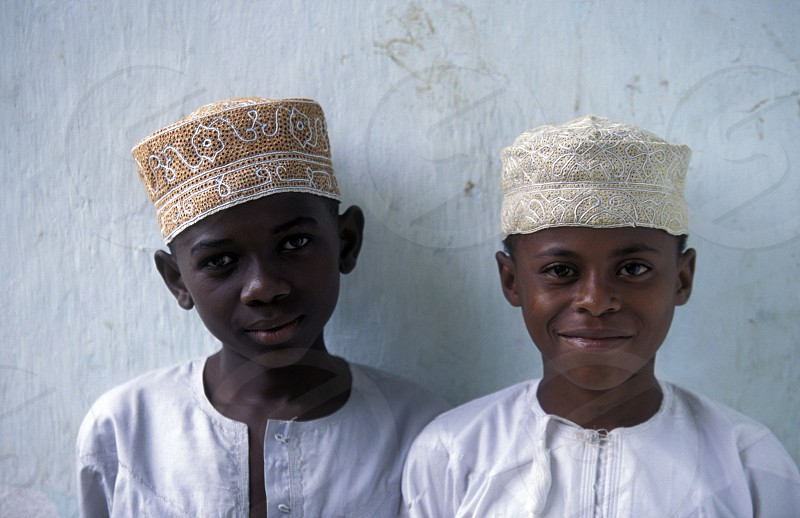 two boys in the city of Moutsamudu on the Island of Anjouan on the Comoros Ilands in the Indian Ocean in Africa.    photo