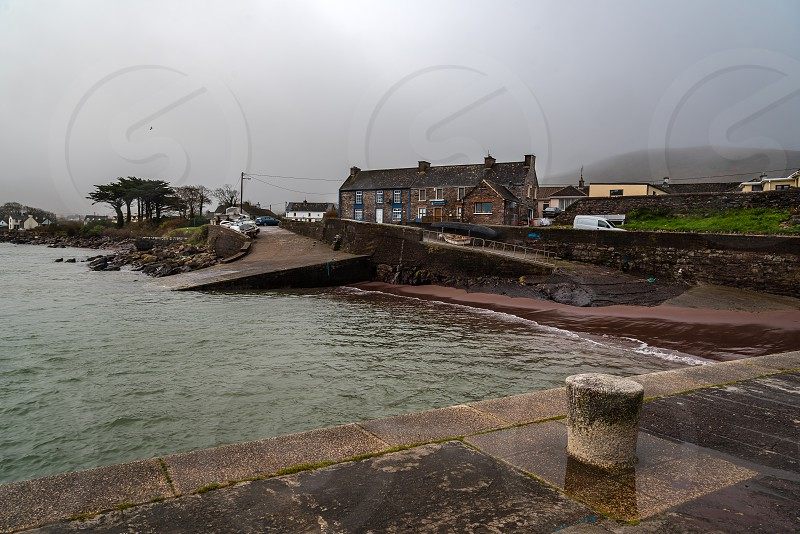 Picturesque harbor in The Model Village in Kerry County Ireland a misty day photo