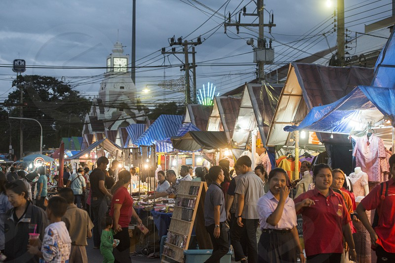 the colck tower with the streetmarket at the Phimai festival in the Town of Phimai in the Provinz Nakhon Ratchasima in Isan in Thailand.  Thailand Phimai November 2017 photo