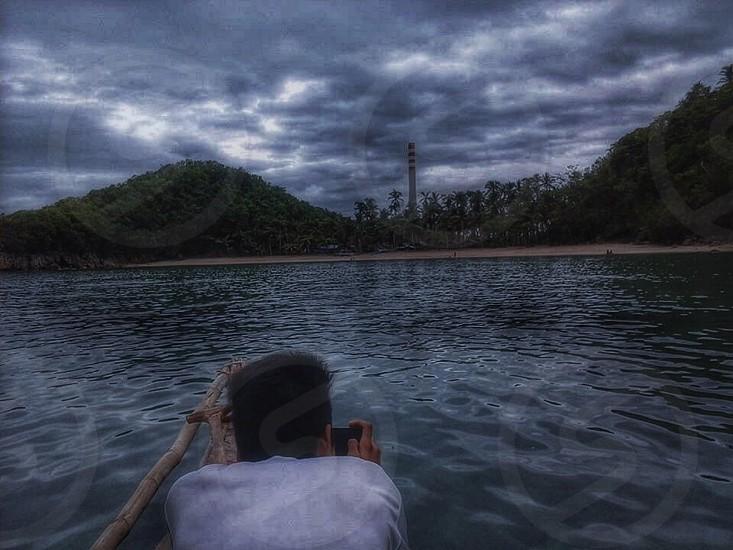 Beachpower plantboatman taking picturemountainsky photo