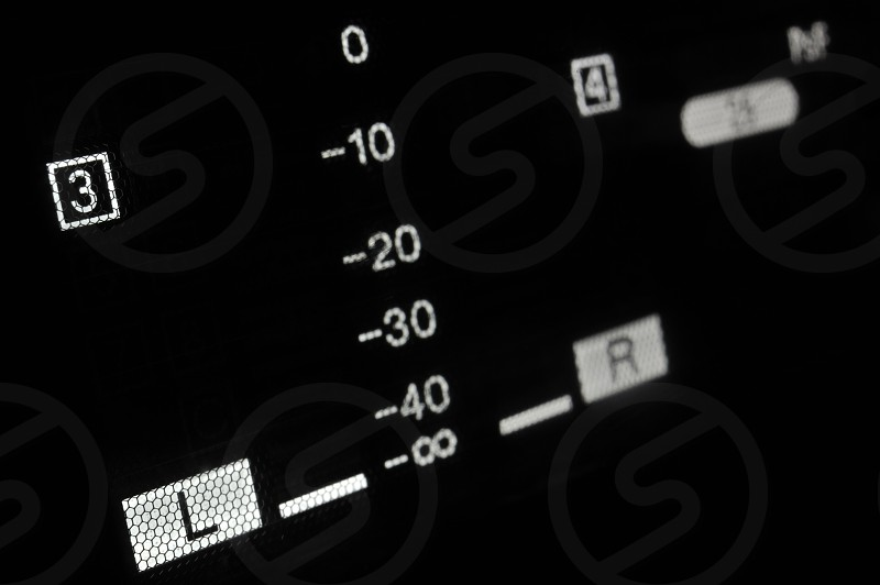 Perspective macro shot of the equalizer display of the professional hdcam video player. Shallow dof. Visible data: sound scale decibels left right channels digits 3 and 4. photo