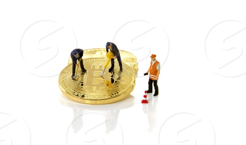 toy miniature figures hacking bitcoin trader photo