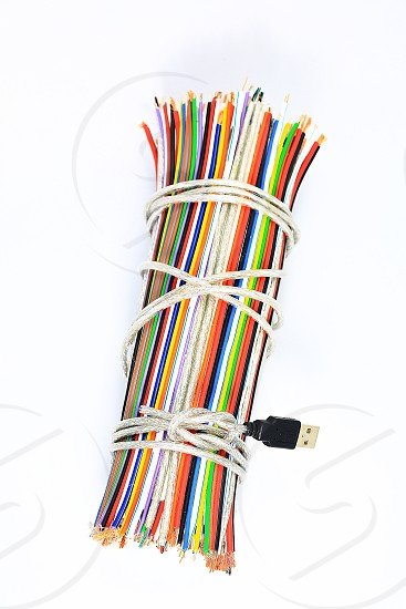 """Topic:""""Bundle of Wires"""" 15  This is an image of a bundle of electronic wires in multiple colors tied up with string with copy space and a clean white background. photo"""