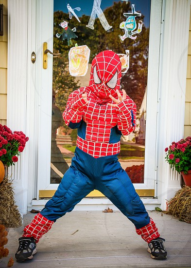 Little boy dressed in spider man costume ready to trick or treat on Halloween  photo