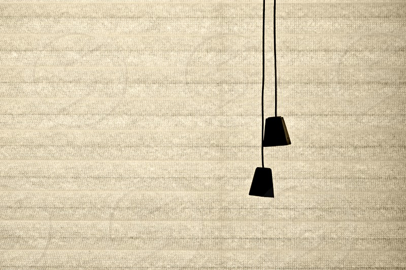 Silhouette of the cords on a beige bamboo  window blind photo