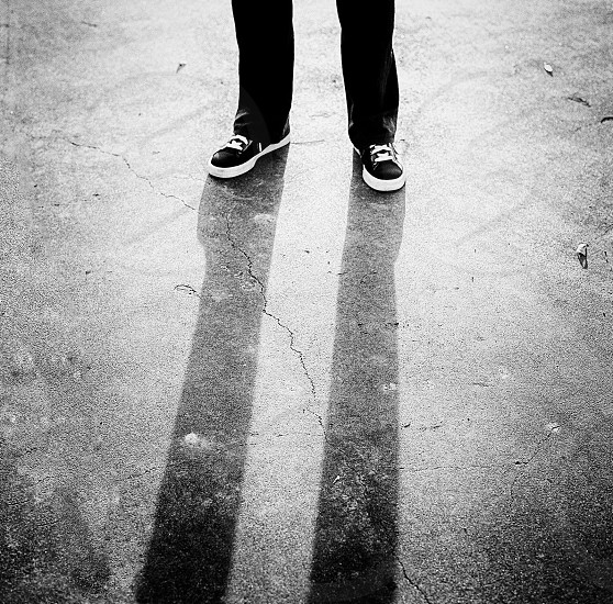 person in black and white shoes photo