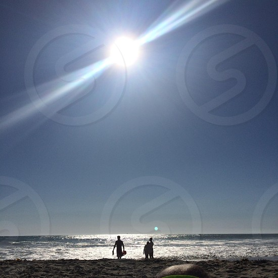 silhouette photo of two person on seahorse under blue sky photo