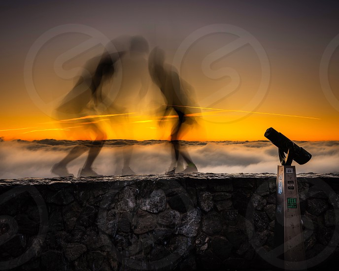 Silhouette sunrise friends long exposure photo