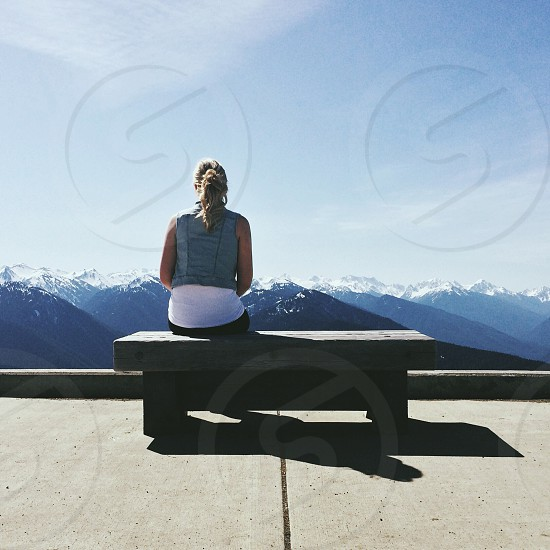 woman sitting on a bench photo