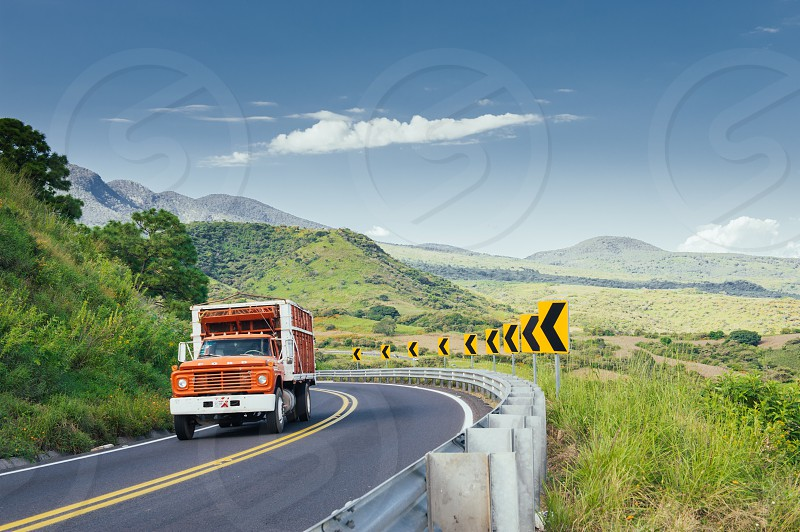 orange white freight truck photo
