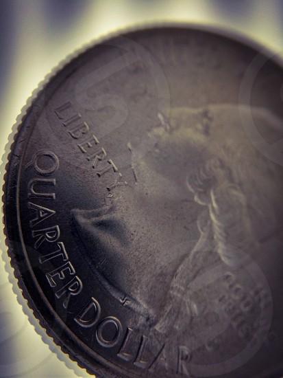 silver quarter dollar coin photo