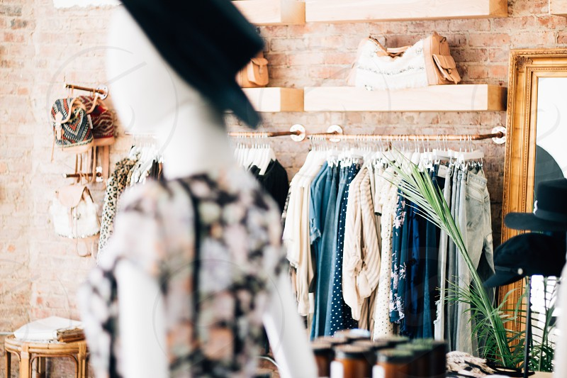 Lifestyle photography of a shop owners fashion boutique. photo
