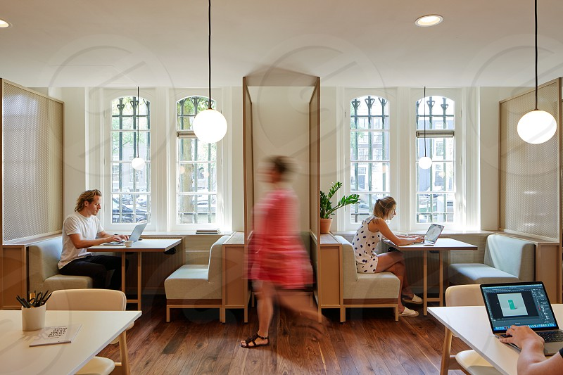 People working in a modern designed office in Amsterdam. photo