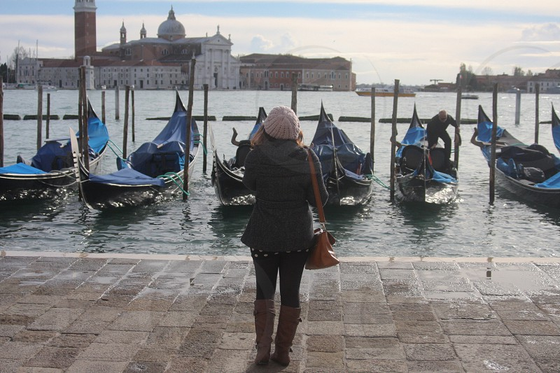 woman in a dock full of boats photo