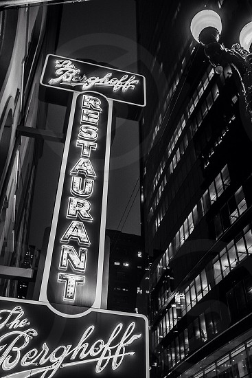 the berghoff restaurant neon light signage grayscale photograph  photo
