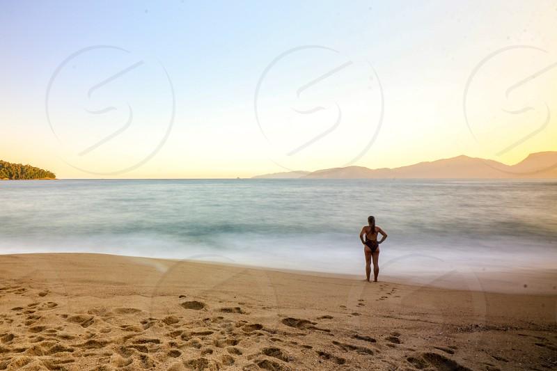 wpomen lookinf sea at sunset photo