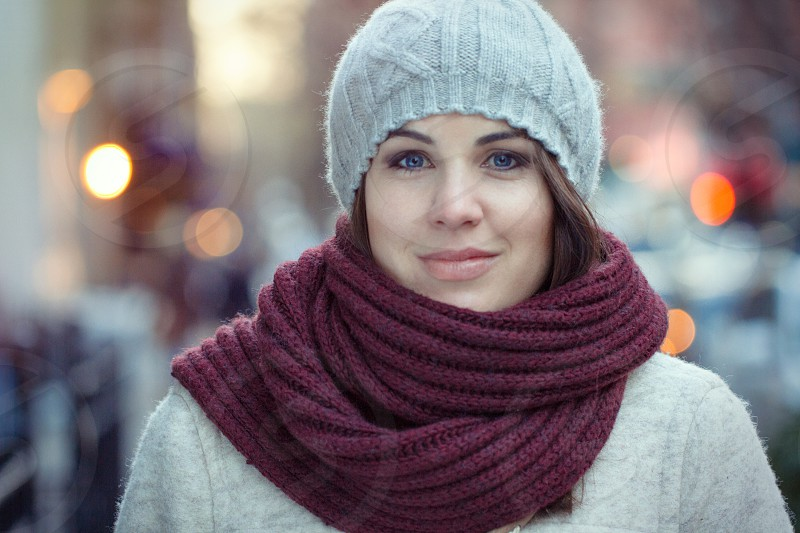 Young woman on the streets of Manhattan bundled up for winter in a scarf and hat. photo