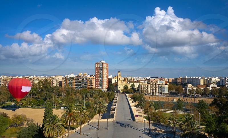 Valencia skyline aerial view and Serranos bridge in Spain photo