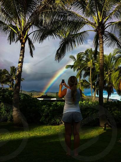 A mobile photographer captures an early morning Hawaiian rainbow.  photo