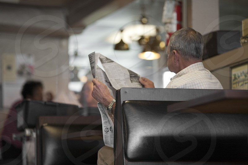 Man reading paper photo