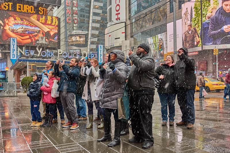 people standing under the rain surrounded by people photo