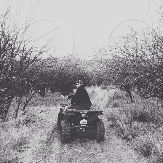 man riding an atv photo