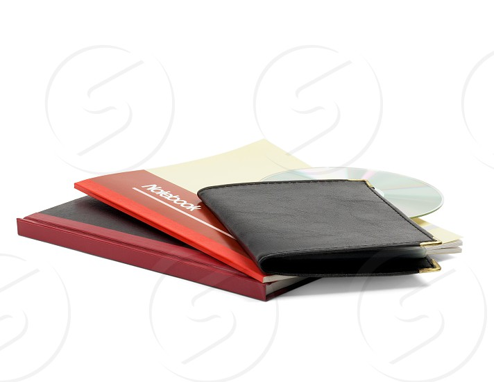 assorted notebooks and cd isolated on white background photo