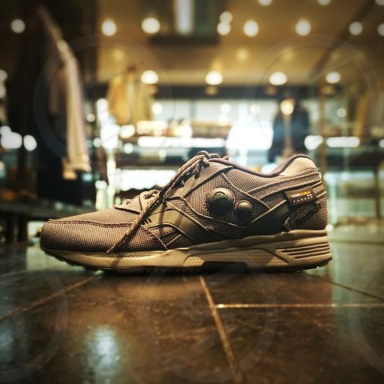 unpaired gray canvas running shoe photo