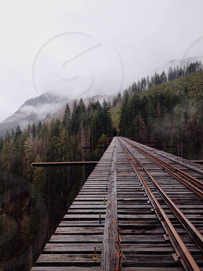 brown wooden railroad photo