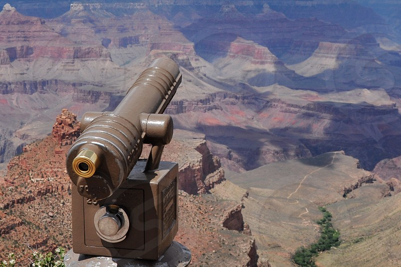 gray metal telescope on brown rocky mountain photo