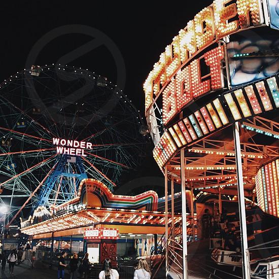 wonder wheel ferris wheel with merry-go-round photo