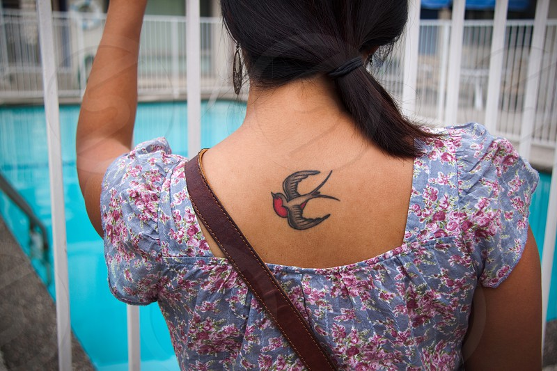 women's bird tattoo photo