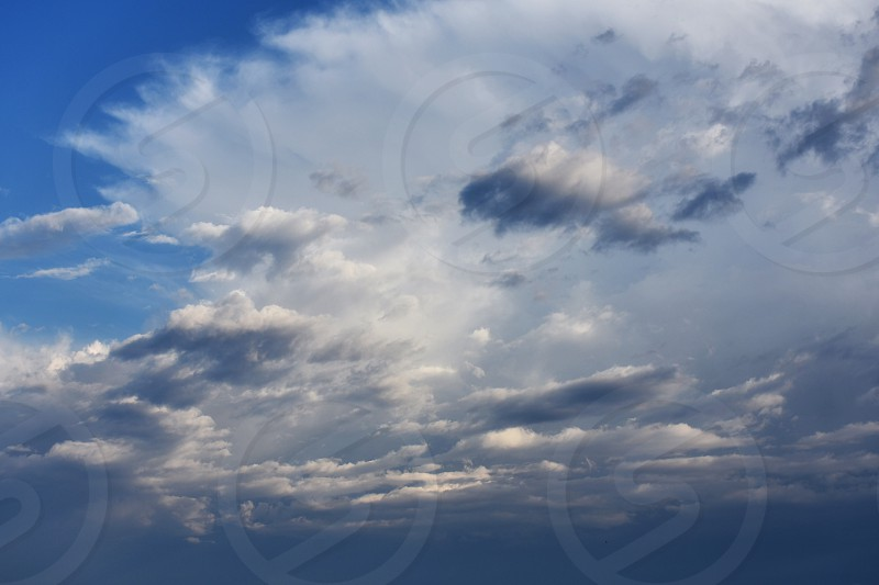 white clouds in blue sky photo