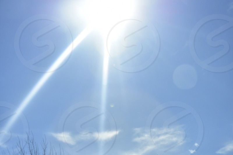 Bright light rays blue sky  photo