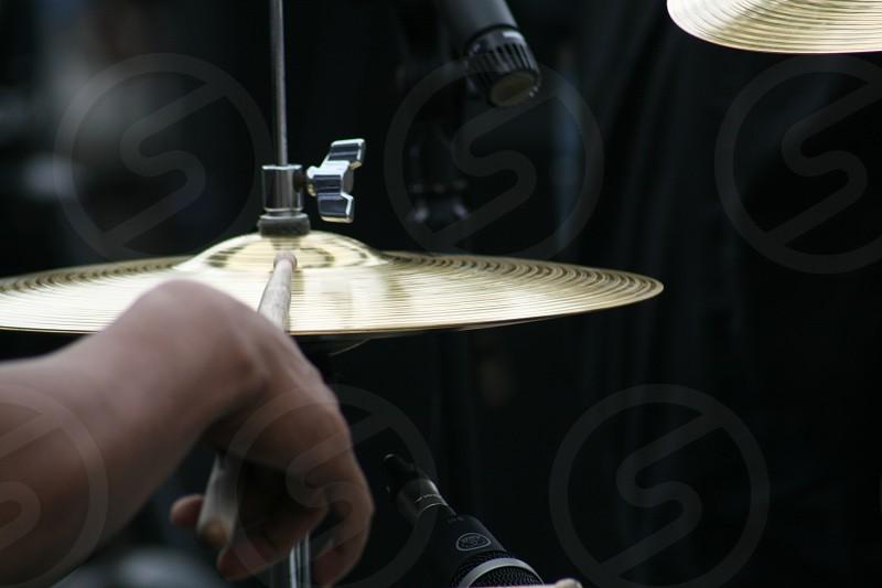 man using brown drum stick hitting snare photo