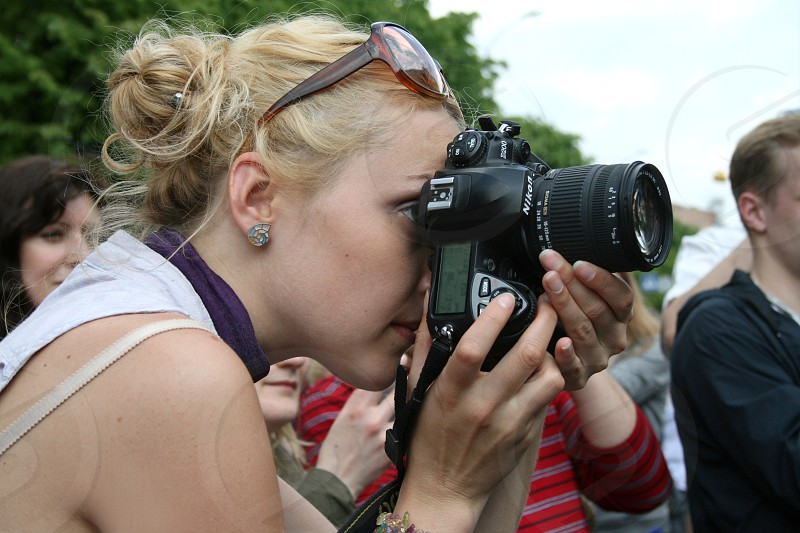 young lady with camera photo