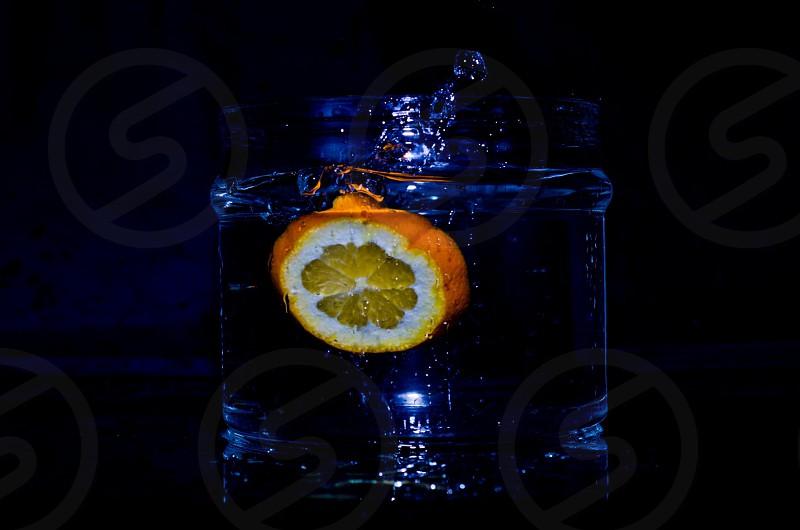 clear glass with lemon inside photo