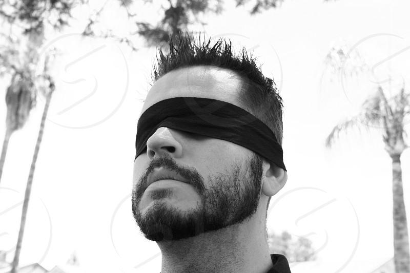 Man Blindfolded Outdoors photo